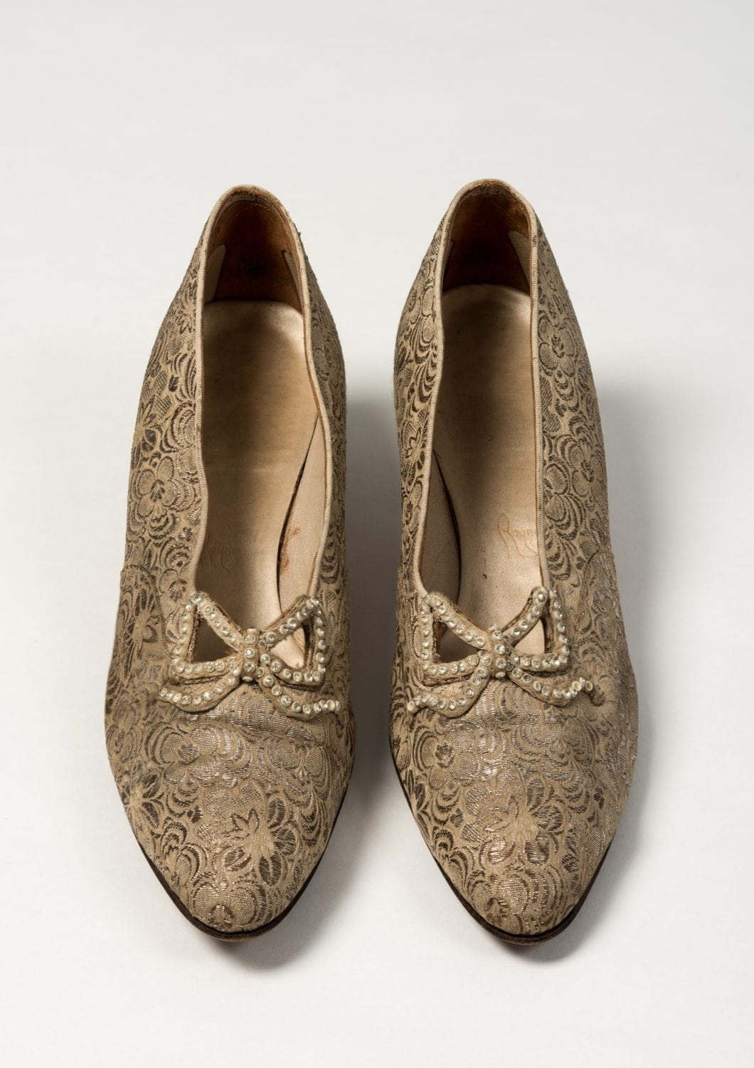 Hand embroided shoes apart of the royal school of needlework collection